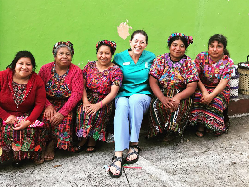 Hospital de la Familia Foundation local women in Guatemala with volunteer