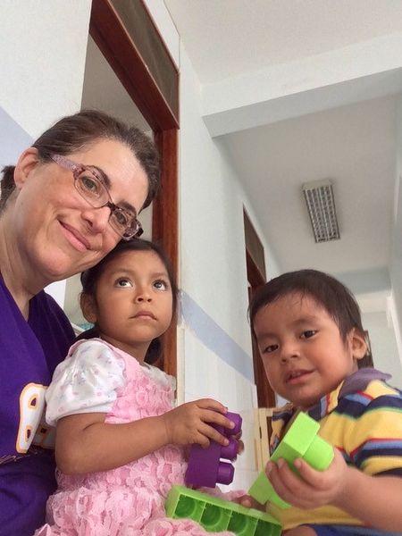 Hospital de la Familia Foundation - doc volunteer with children