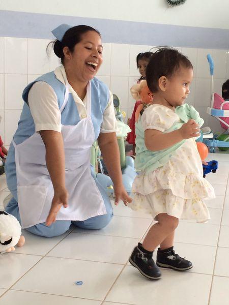 Hospital de la Familia Foundation - nurse with little ones